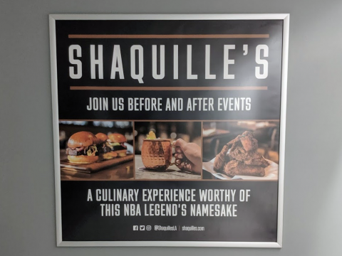 Tempting Shaquille's ad in the men's room at Staples Center